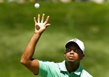 Tiger Woods of the U.S. catches his ball on the fifth green during the third round of the Barclays PGA golf tournament in Jersey City, New Jersey August 24, 2013.   REUTERS/Adam Hunger