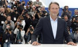 """Cast member Mads Mikkelsen poses during a photocall for the film """"Michael Kohlhaas"""" at the 66th Cannes Film Festival in Cannes May 24, 2013.        REUTERS/Jean-Paul Pelissier"""
