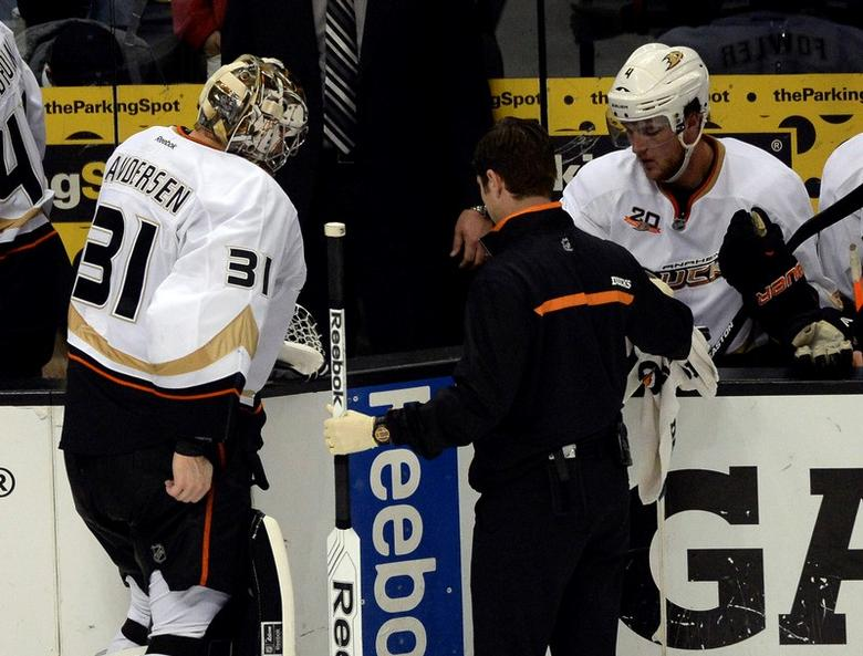 May 8, 2014; Los Angeles, CA, USA; Anaheim Ducks goalie Frederik Andersen is escorted to the bench after sustaining an injury during the third period in game three of the second round of the 2014 Stanley Cup Playoffs against the Los Angeles Kings at Staples Center.  Richard Mackson-USA TODAY Sports