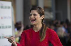 """Cast member Lake Bell smiles at the premiere of """"Million Dollar Arm"""" at El Capitan theatre in Hollywood, California May 6, 2014.   REUTERS/Mario Anzuoni"""