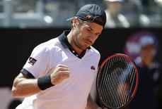 Tommy Haas of Germany reacts as he challenges Stanislas Wawrinka of Switzerland during their men's singles match at the Rome Masters tennis tournament May 15, 2014. REUTERS/Max Rossi