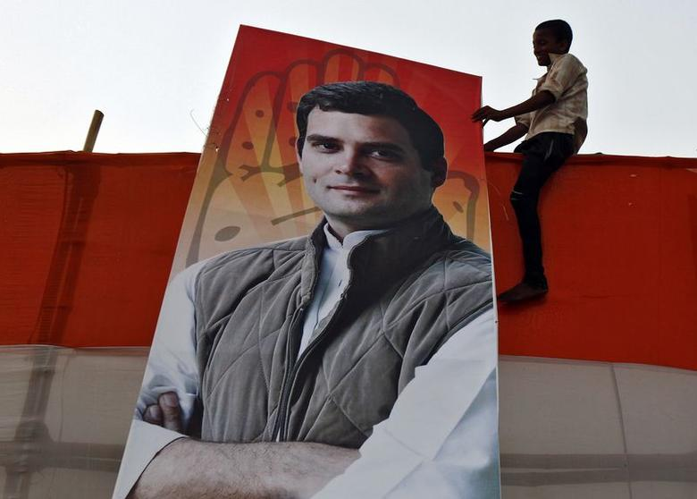 A boy holds a poster of Rahul Gandhi, Congress party's vice president and son of Congress chief Sonia Gandhi, after an election campaign rally in Kolkata May 8, 2014. REUTERS/Rupak De Chowdhuri