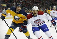 Mar 16, 2014; Buffalo, NY, USA; Buffalo Sabres center Zenon Konopka (24) and Montreal Canadiens defenseman Mike Weaver (43) go after the puck during the second period at First Niagara Center. Mandatory Credit: Timothy T. Ludwig-USA TODAY Sports