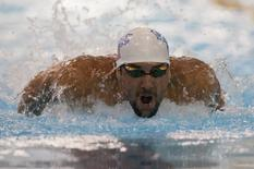 May 16, 2014; Charlotte, NC, USA; Michael Phelps swims in the 100 meter butterfly final at Mecklenburg County Aquatic Center. Mandatory Credit: Jeremy Brevard-USA TODAY Sports