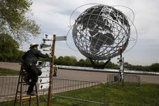 An artist works on a piece marking the 50th anniversary of the 1964 World's Fair at Flushing Meadows -Corona Park in the Queens borough of New York May 12, 2014.  REUTERS/Shannon Stapleton