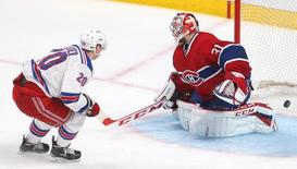 May 17, 2014; Montreal, Quebec, CAN; New York Rangers left wing Chris Kreider (20) scores a goal against Montreal Canadiens goalie Carey Price (31) during the second period in game one of the Eastern Conference Finals of the 2014 Stanley Cup Playoffs at Bell Centre. Jean-Yves Ahern-USA TODAY Sports