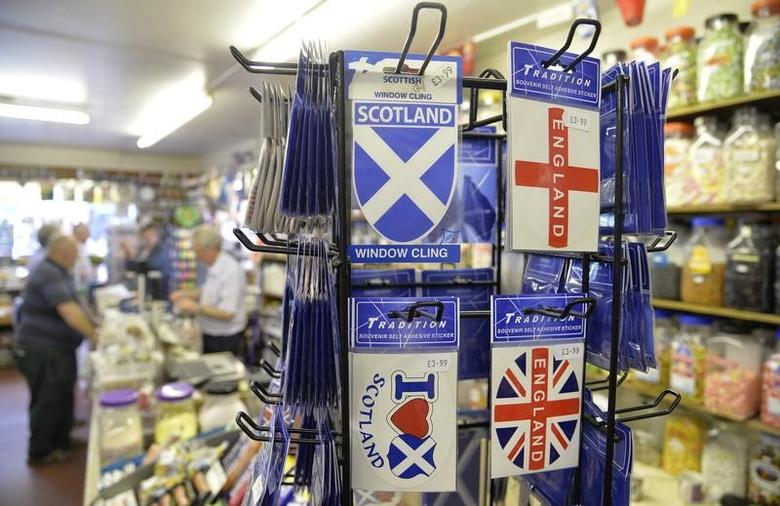 England and Scotland stickers are seen as shoppers queue in a sweet shop in Berwick Upon Tweed in Northumberland August 20, 2013. REUTERS/Toby Melville