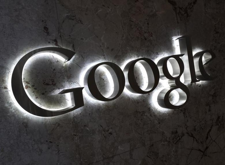 A Google logo is seen at the entrance to the company's offices in Toronto September 5, 2013. REUTERS/Chris Helgren/Files
