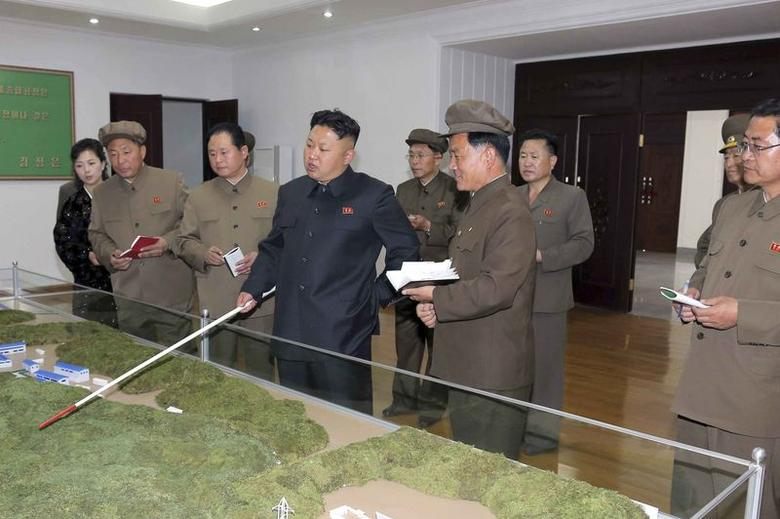 North Korean leader Kim Jong Un visits the January 18 General Machinery Plant, where he specified tasks and methods for its modernisation, in this undated photo released by North Korea's Korean Central News Agency (KCNA) in Pyongyang on May 14, 2014. REUTERS/KCNA