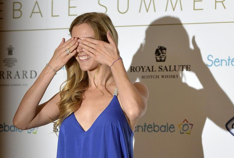 British singer Joss Stone gestures as she arrives at the 'Sentebale Summer Party' in London May 7, 2014. REUTERS/Toby Melville