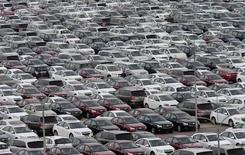Автомобили General Motors в Шэньяне, КНР 21 апреля 2014 года. General Motors Co отзовёт еще 2,6 миллиона автомобилей по всему миру, доведя таким образом общее число отозванных в этом году машин почти до 15,4 миллиона, сообщила компания. REUTERS/Stringer