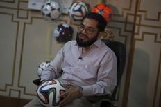 Khawaja Masood Akhtar, CEO of Forward Sports which manufactures the official World Cup ball, talks to Reuters during an interview at its factory in Sialkot May 16, 2014.  REUTERS/Sara Farid