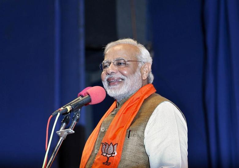 Narendra Modi, who will be the next prime minister , smiles as he addresses Gujarat state lawmakers and party workers during the appointment of the state's new chief minister in Gandhinagar May 21, 2014. REUTERS/Amit Dave