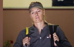 Maria Sharapova of Russia looks on before her women's singles match against Ana Ivanovic of Serbia at the Rome Masters tennis tournament May 15, 2014. REUTERS/Max Rossi