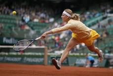 Ksenia Pervak of Russia hits a return to compatriot Maria Sharapova during their women's singles match at the French Open tennis tournament at the Roland Garros stadium in Paris May 26, 2014.        REUTERS/Gonzalo Fuentes