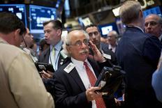 Traders work on the floor of the New York Stock Exchange May 23, 2014. REUTERS/Brendan McDermid