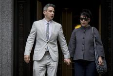 """Beastie Boys member Adam Horovitz, a.k.a. """"Ad-Rock,"""", exits the U.S. District Court for the Southern District of New York in Lower Manhattan with his wife punk singer Kathleen Hanna, May 27, 2014.  REUTERS/Brendan McDermid"""