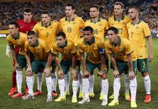 The Australian team stand together before the start of their international friendly soccer match against South Africa at Stadium Australia in Sydney May 26, 2014.     REUTERS/David Gray     (AUSTRALIA - Tags: SPORT SOCCER WORLD CUP) - RTR3QWC0