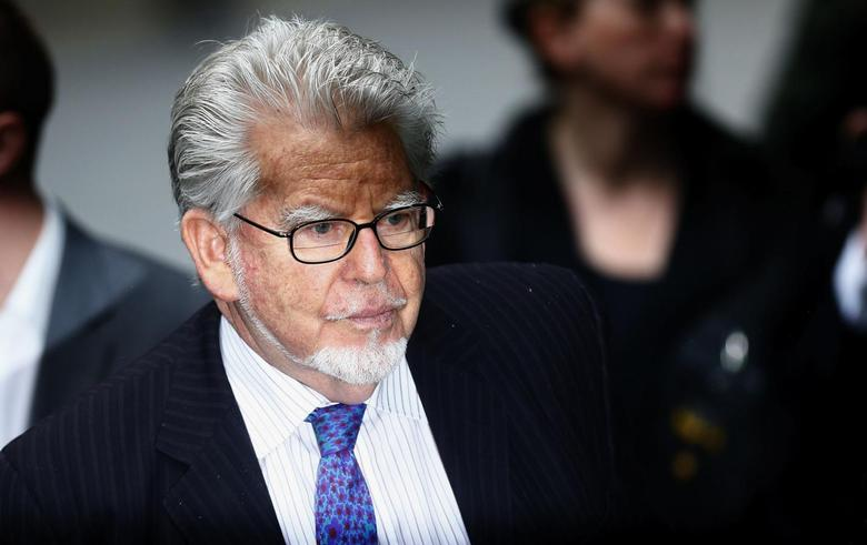 Entertainer Rolf Harris arrives Southwark Crown Court in London May 27, 2014. Harris is charged with indecent assault, and denies the charges. REUTERS/Andrew Winning