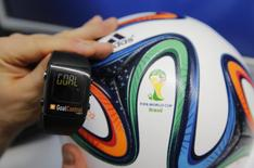 A GoalControl watch is displayed next to an official FIFA 2014 World Cup Brazil football during a demonstration of the goal-line technology in the western German city of Aachen May 28, 2014. REUTERS/Wolfgang Rattay