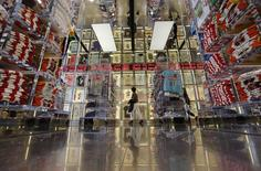 A shopper walks in a clothing retail store at Ginza shopping district in Tokyo April 28, 2014. REUTERS/Toru Hanai