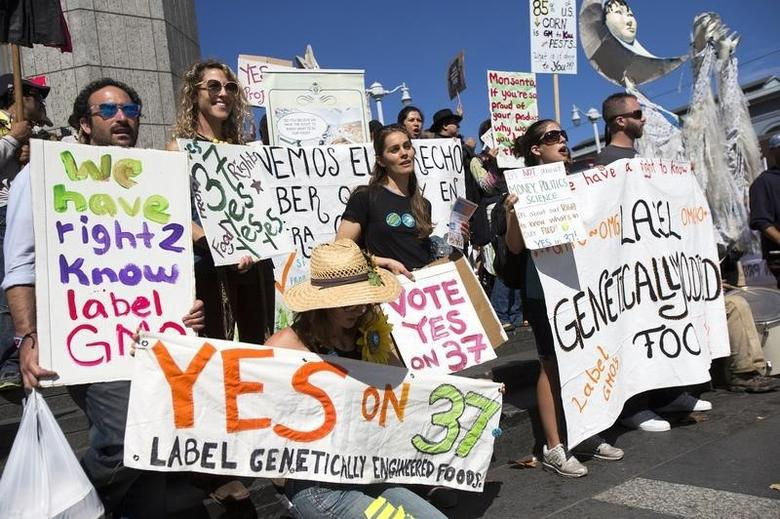 A group of demonstrators hold signs during a rally in support of the state's upcoming Proposition 37 ballot measure outside the Ferry Building in San Francisco, California October 6, 2012.  REUTERS/Stephen Lam