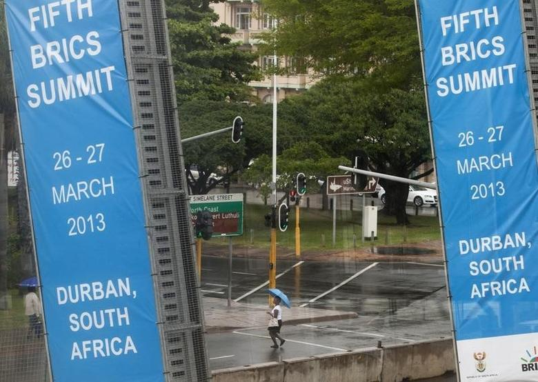 A woman walks past the International Convention Centre where the 5th BRICS Summit was held, in Durban March 25, 2013. REUTERS/Rogan Ward/Files
