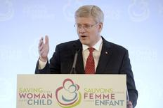"""Canada's Prime Minister Stephen Harper speaks during the closing news conference for the """"Saving Every Woman, Every Child: Within Arm's Reach"""" Summit in Toronto May 30, 2014. REUTERS/Aaron Harris"""
