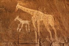 Vandalised rock art is pictured at Tadrart Acacus May 30, 2014. REUTERS/Aimen Elsahli