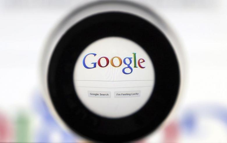 A Google search page is seen through a magnifying glass in this photo illustration taken in Brussels May 30, 2014. REUTERS/Francois Lenoir/Files