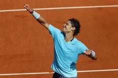 Rafael Nadal of Spain celebrates after winning his men's semi-final match against Andy Murray of Britain at the French Open tennis tournament at the Roland Garros stadium in Paris June 6, 2014.        REUTERS/Jean-Paul Pelissier