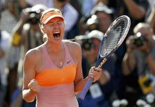Maria Sharapova of Russia reacts after winning her women's singles final match against Simona Halep of Romania at the French Open tennis tournament at the Roland Garros stadium in Paris June 7, 2014.                        REUTERS/Vincent Kessler