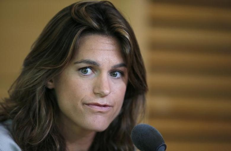 Former French tennis player Amelie Mauresmo speaks during a news conference at the French Open Tennis tournament at the Roland Garros stadium in Paris June 8, 2014. REUTERS/Gonzalo Fuentes