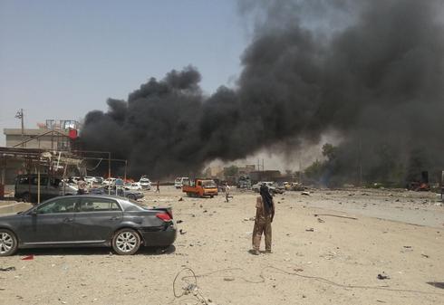 Twin bombing near Kurdish party office in north Iraq kills 30