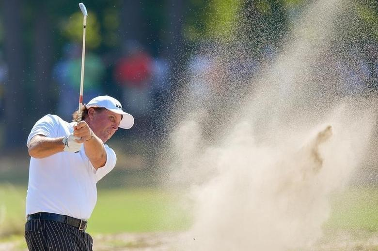 Jun 10, 2014; Pinehurst, NC, USA; Phil Mickelson in the sand trap on the 7th hole during a practice round for the U.S. Open golf tournament at Pinehurst No. 2 at Pinehurst Resort & Country Club. Mandatory Credit: Kevin Liles-USA TODAY Sports - RTR3T41G