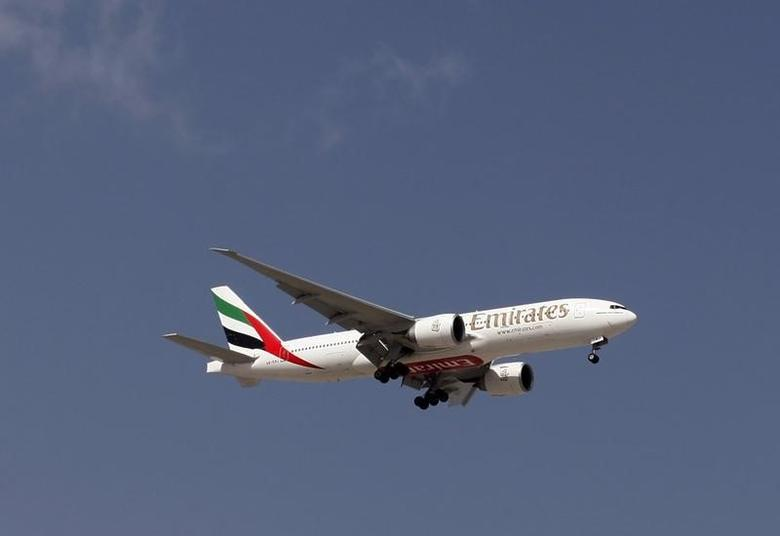 An Emirates Airlines plane lands at the Emirates terminal at Dubai International Airport, February 6, 2012. REUTERS/Jumana El Heloueh