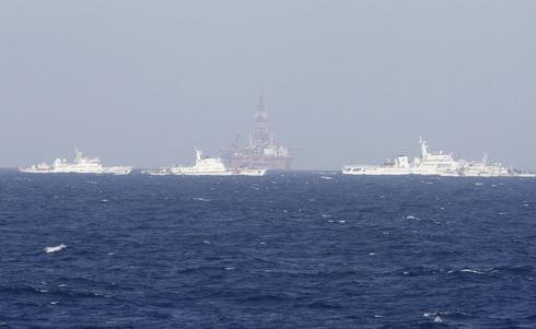 Vietnam says China moving rig; China denies sending warships