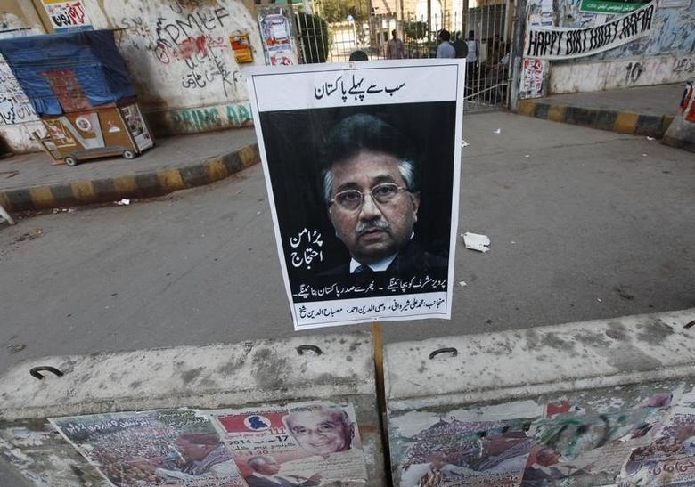 A placard of former President Pervez Musharraf, head of the All Pakistan Muslim League (APML) political party, is left behind by his supporter after a protest demanding a fair trial for him in Karachi March 9, 2014. REUTERS/Akhtar Soomro