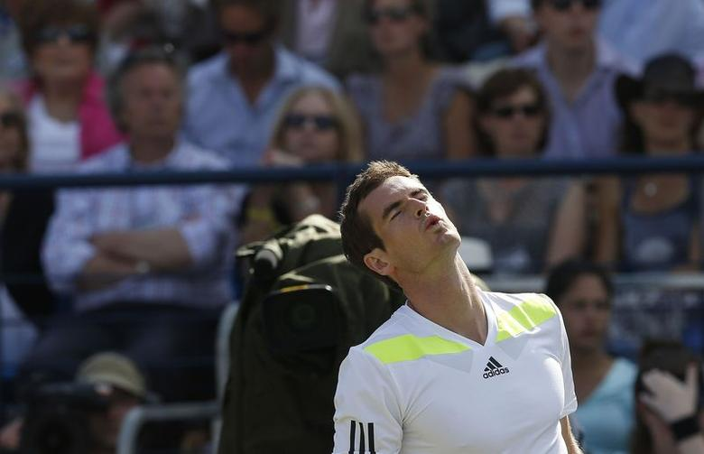 Britain's Andy Murray reacts during his match against Czech Republic's Radek Stepanek at the Queen's Club Championships in west London June 12, 2014. REUTERS/Suzanne Plunkett