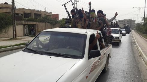 ISIL fighters in Mosul