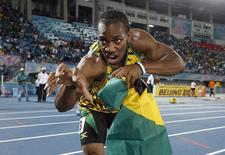 Jamaica's Yohan Blake poses for photographers after Jamaica set a new world record in winning the 4x200 metres relay at the IAAF World Relays Championships in Nassau, Bahamas, May 24, 2014. REUTERS/Mike Segar