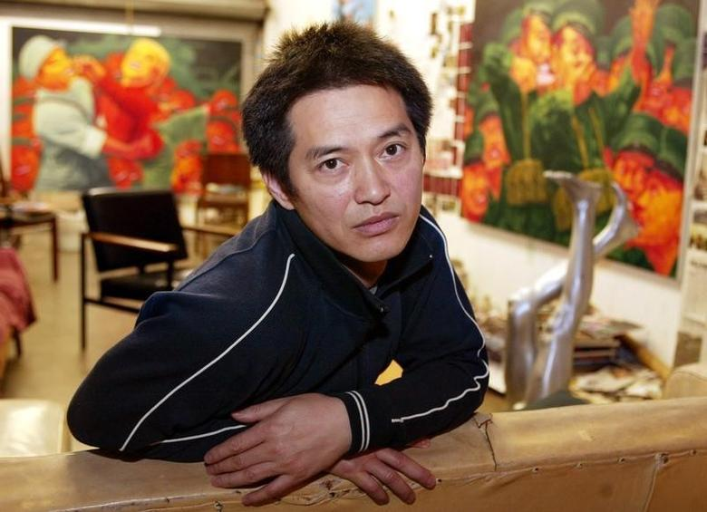 Chinese-born artist Guo Jian is pictured in a converted garage which serves as his studio in Sydney's inner western suburbs March 23, 2004. REUTERS/Will Burgess