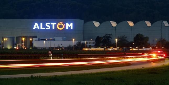 A car drives past a plant of French engineering group Alstom in the Swiss town of Birr, west of Zurich, October 4, 2010.  REUTERS/Arnd Wiegmann
