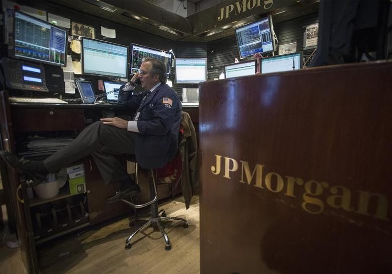 A trader works at the JP Morgan stall on the floor of the New York Stock Exchange, November 19, 2013.REUTERS/Brendan McDermid