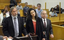 Andrew Bowman (L), attorney for singer Edie Brickell (C) and her husband singer Paul Simon (L), speaks at the Norwalk Superior Court in Norwalk, Connecticut May 16, 2014. REUTERS/Douglas Healey