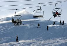 """People spend their day at the """"Valle Nevado"""" ski center, east of Santiago, in the Los Andes mountain range, June 16, 2007. The Chilean and Argentine Andes are a long way to go for a ski vacation for most, but 2014 might be the year to make the trip way south as an expected """"El Nino"""" weather pattern raises hopes of abundant powder. Although not on the scale of the Alps or Rockies, an increasingly impressive string of Andean resorts host modern facilities, relatively uncrowded slopes, and high-quality ski schools. Picture taken June 16, 2007. REUTERS/Stringer (CHILE - Tags: SPORT SKIING ENVIRONMENT SOCIETY TRAVEL) - RTR3PDWL"""