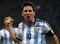 Jogador argentino Lionel Messi celebra gol em jogo contra Bósnia, no Maracanã, Rio de Janeiro. REUTERS/Michael Dalder