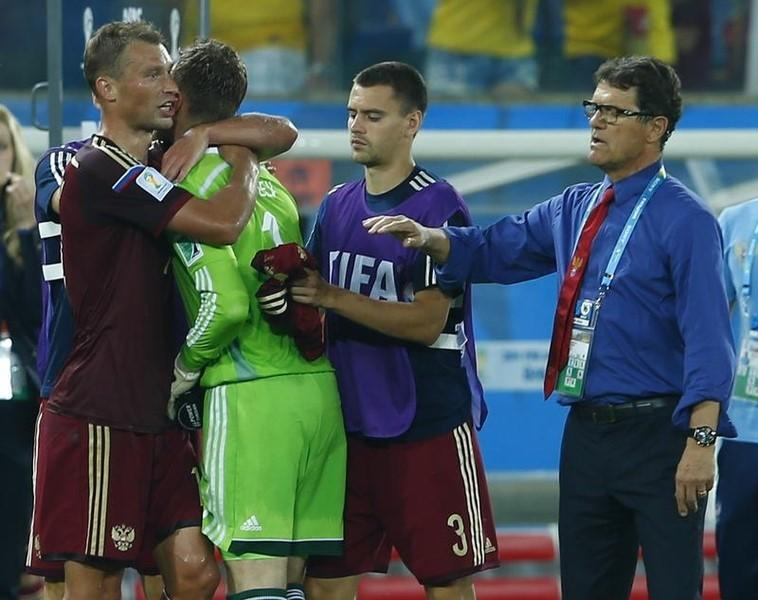 Russia s Igor Akinfeev (2nd L) is comforted by teammates Vasili Berezutskiy  (L) and Georgi Schennikov and team coach Fabio Capello at the end of their  2014 ... 4750307eb519
