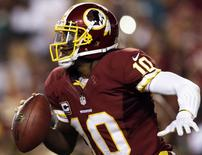 Washington Redskins quarterback Robert Griffin III scrambles against the Philadelphia Eagles' defense during the second half of their NFL football game in Landover, Maryland  in this file photo from September 9, 2013.  REUTERS/Gary Cameron/Files