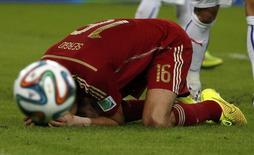 Jogador espanhol Sergio Busquets após perder chance de gol contra o Chile, no Maracanã, Rio de Janeiro. 18/6/2014 REUTERS/Jorge Silva